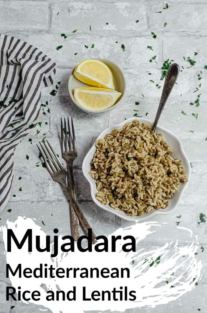 A white bowl with scalloped edges filled with mujadara (Middle Eastern rice and lentils dish)