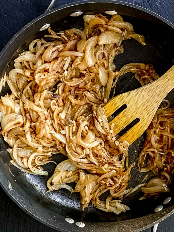 onions browning in a pan