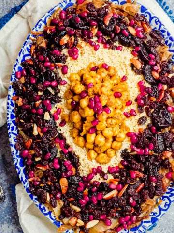 Close up overhead view of an oval serving dish with moroccan couscous