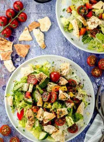 Bird's eye view of two white plates with Fattoush salad
