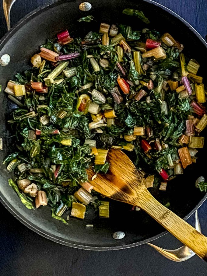 Wilted rainbow chard on a large skillet