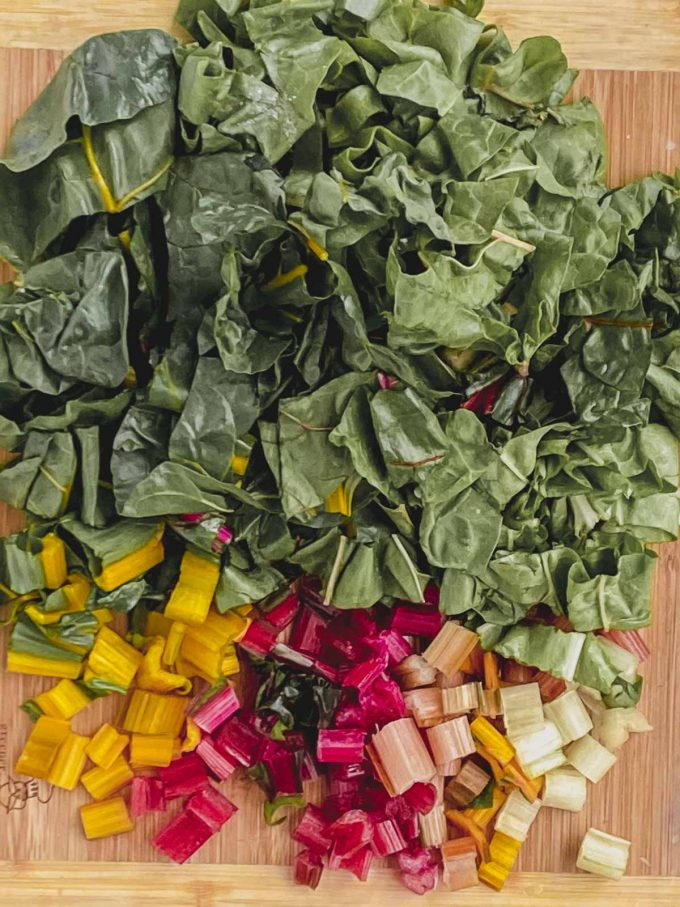 Chopped Chard stems and leaves on a wood cutting board