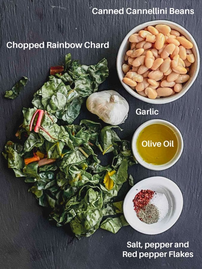 Ingredients to make chard with bean labeled: Rainbow chard, garlic, olive oil, canned cannellini bean, salt, pepper and red pepper flakes
