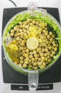 Herbs, chickpeas and lemon zest in a food processor