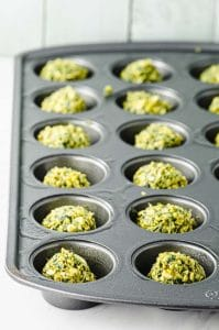 Side view of a mini muffin tin with falafel balls