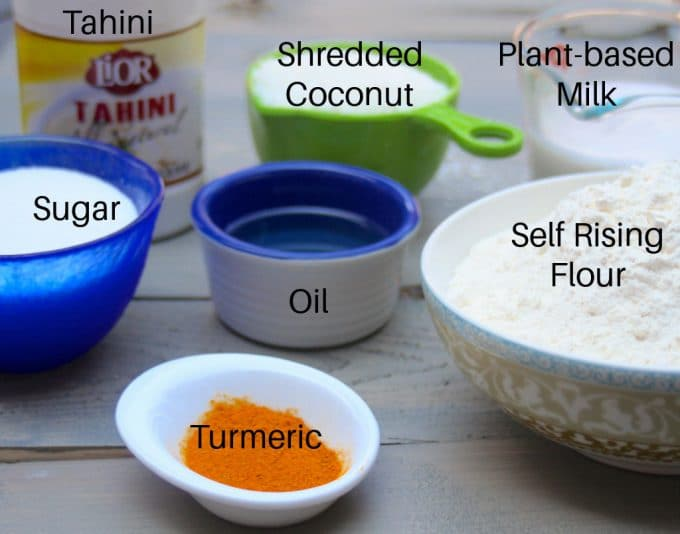 Ingredients to make turmeric cake (sfouf) - Self rising flour, turmeric, oil, shredded coconut, plant-based milk, sugar, tahini
