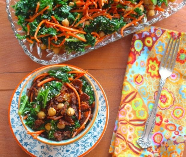 Bird's eye view of a bowl of kale salad and a serving dish with kale salad