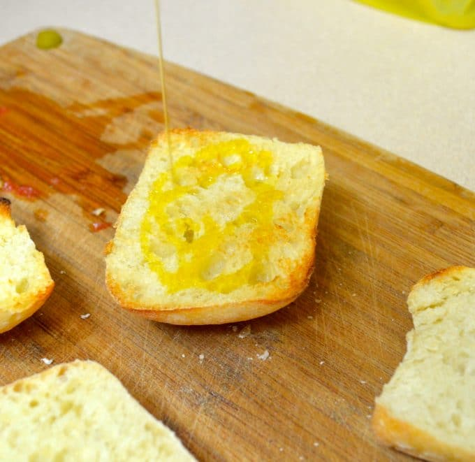 pan con tomate - drizzle of olive oil on toasted bread