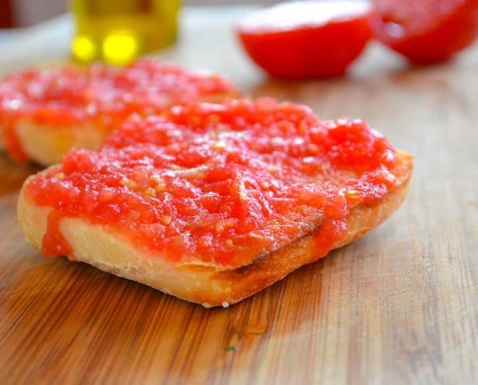 a piece of pan con tomate con toasted cabbala bread