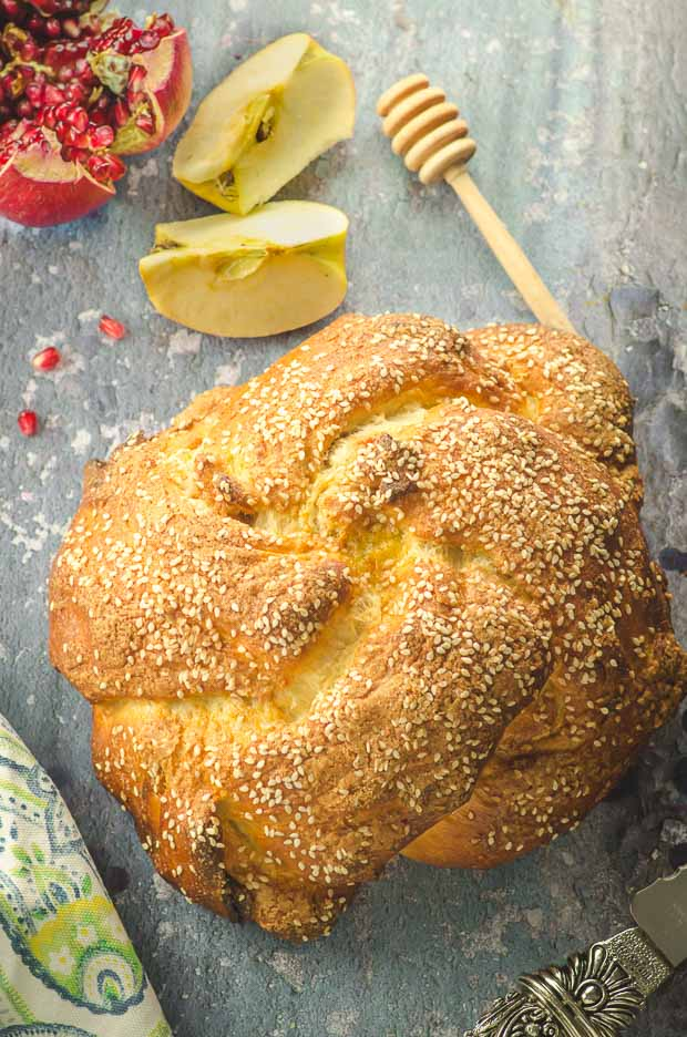 Bird's eye view of an apple and honey round challah