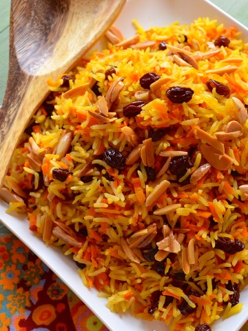 Sweet Rosh Hashanah Rice with Carrots and Raisins on a square plate. Bird's eye view
