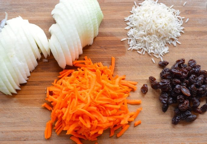 Carrots, raisins and rice, the ingredients for a sweet basmati rice