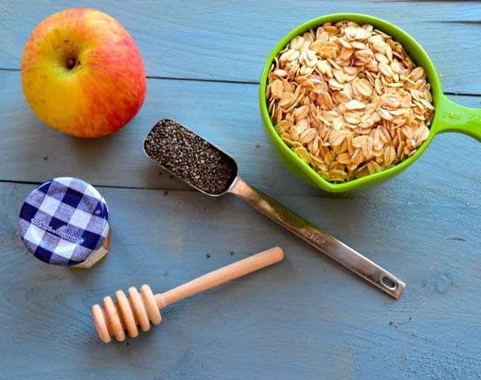 Ingredients to make overnight oats. Oats, chia seeds, apple and honey