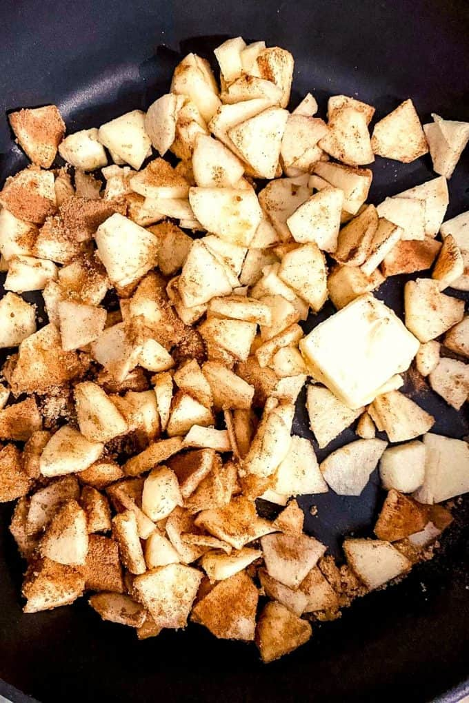 an overhead view of diced apples with cinnamon sugar mixture