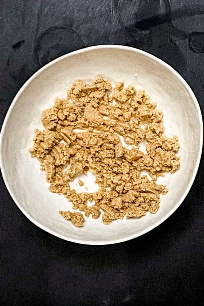 overhead view of crumble mixture prepared in a bowl