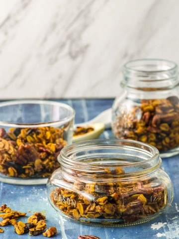 Three assorted shapes glass jars filled with savory granola