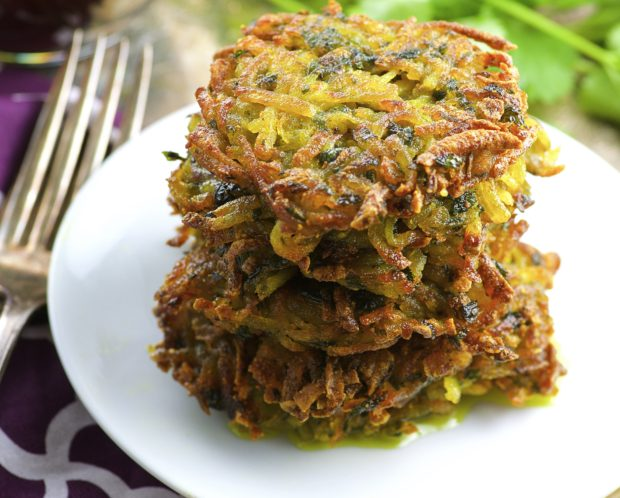 Vegan Potato Latkes flavored with cilantro and turmeric and nice little twist to this chanukah ( hanukkah) favorite.