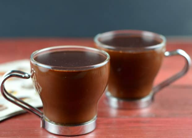 2 four ounce clear mugs of hot chocolate, Barcelona style. Thick , rich and decadent