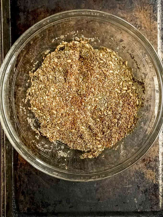 Flax and chia seeds soaking in a glass bowl