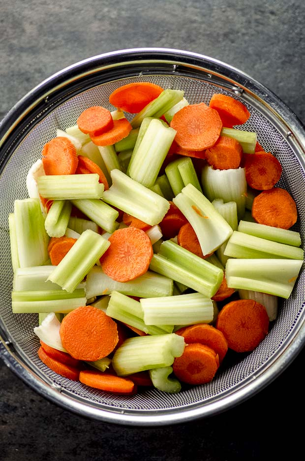 Bird's eye view of a colander filled with celery and carrots
