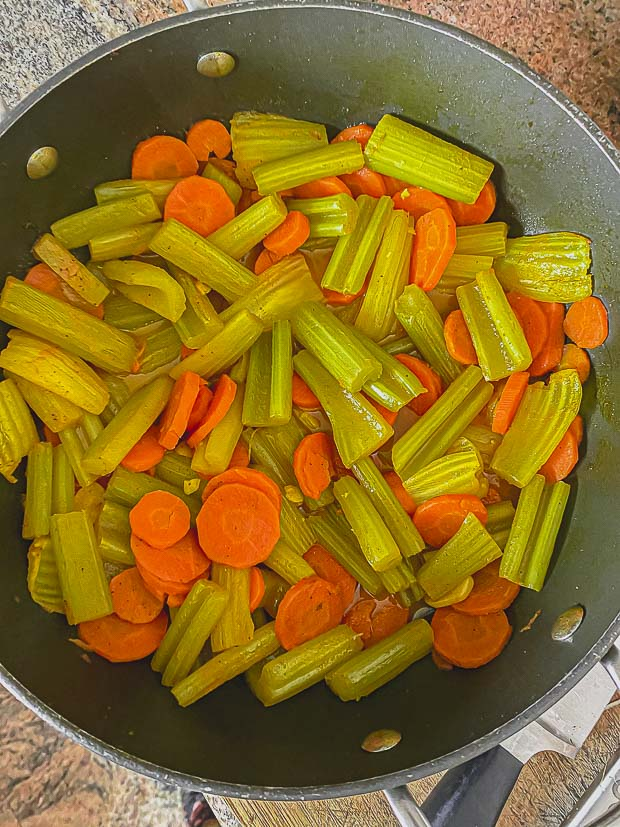 birds' eye view of a pan with celery and carrots cooking