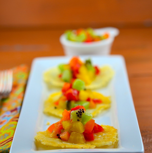 parmesan crisps on pepper kiwi salsa