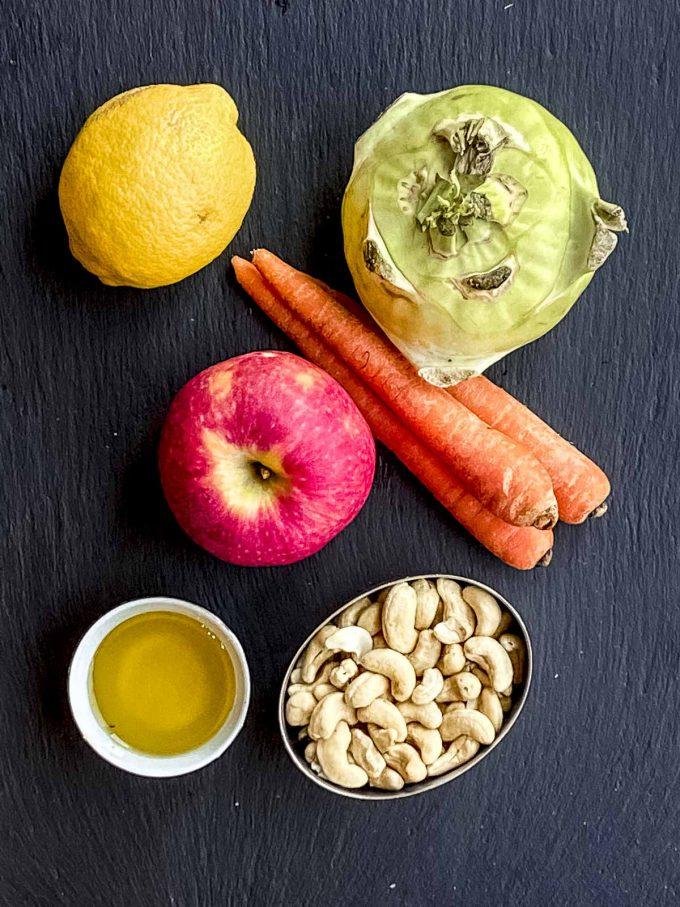 Ingredients for Kohlrabi slaw: kohlrabi, carrots, apple, lemon and raw cashews