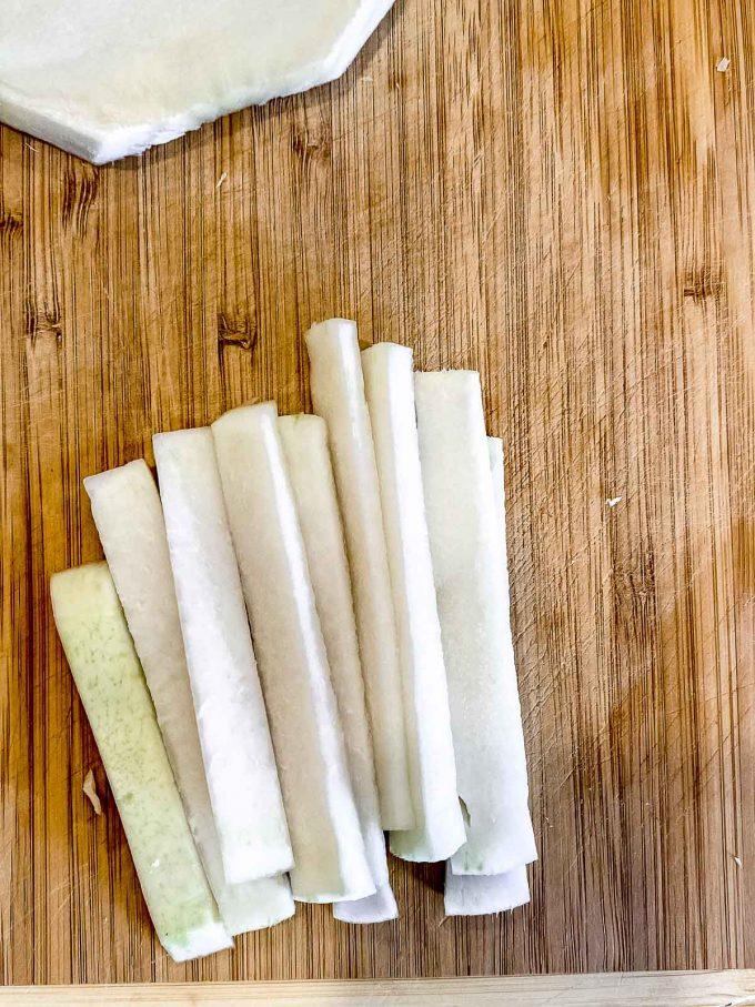 Kohlrabi cut into thin sticks to make slaw