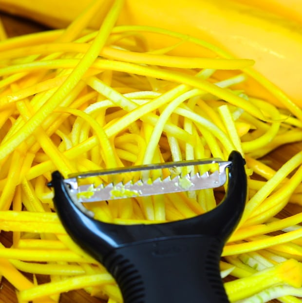 Yellow zucchini strips made with a julienne peeler