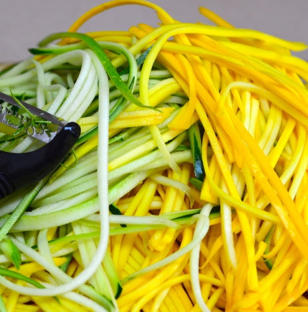 Yellow and Green Zucchini Spaghetti with basil and Pine Nuts
