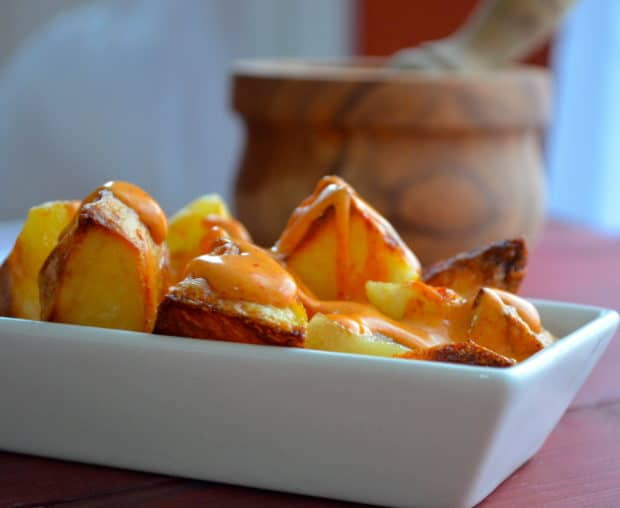 Close up view of a typical tapa from Spain: Patatas Bravas