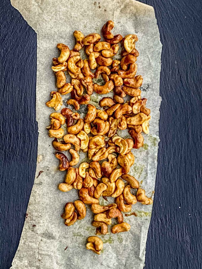 Letting cashews cool in a piece or parchment paper