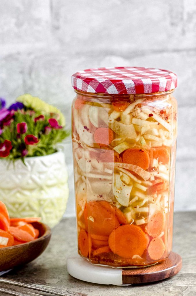 A closed jar of pickled carrots and fennel