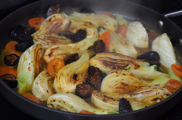 Close up of Braised Fennel with Apricots & Figs in a skillet cooking on the stove