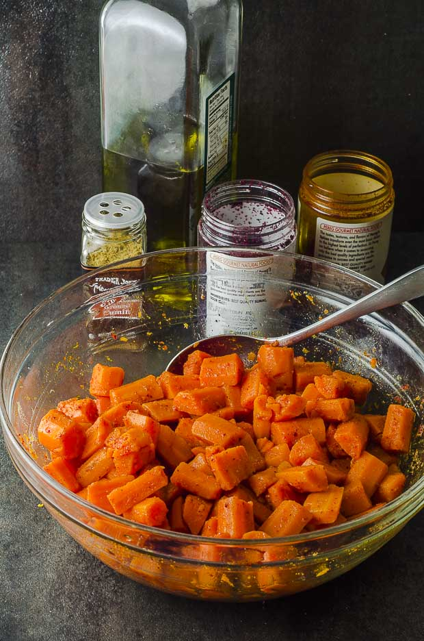 Seasoned carrots in a clear glass bowl