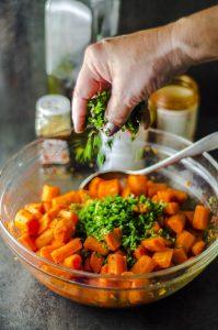 Adding cilantro to moroccan carrot salad