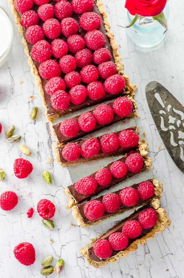 Bird's eye view of a stunning vegan raspberry chocolate tart