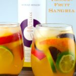 two glasses filled with Summery Passion Fruit Sangria