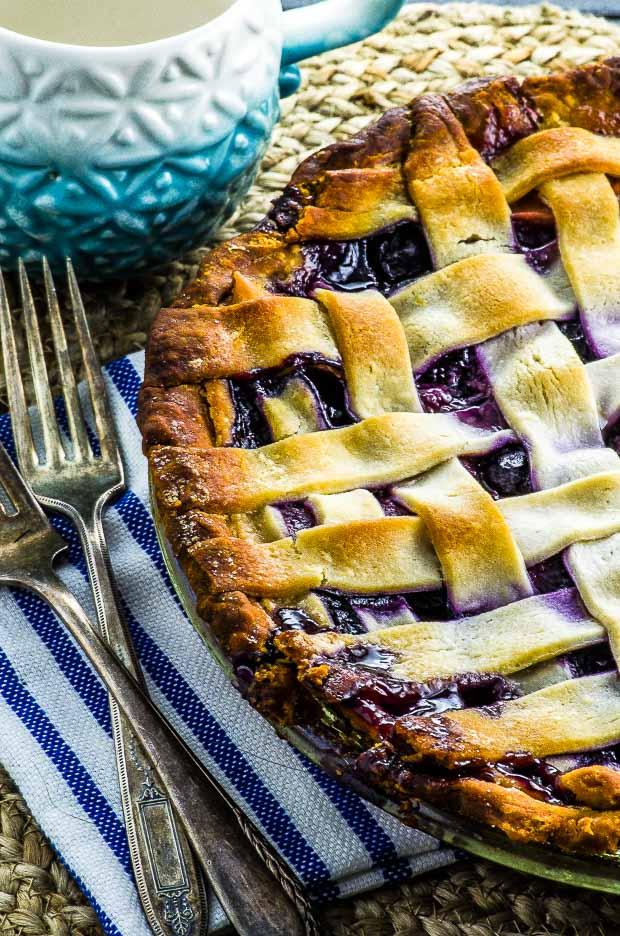 Peach blueberry pie with a cup of coffee