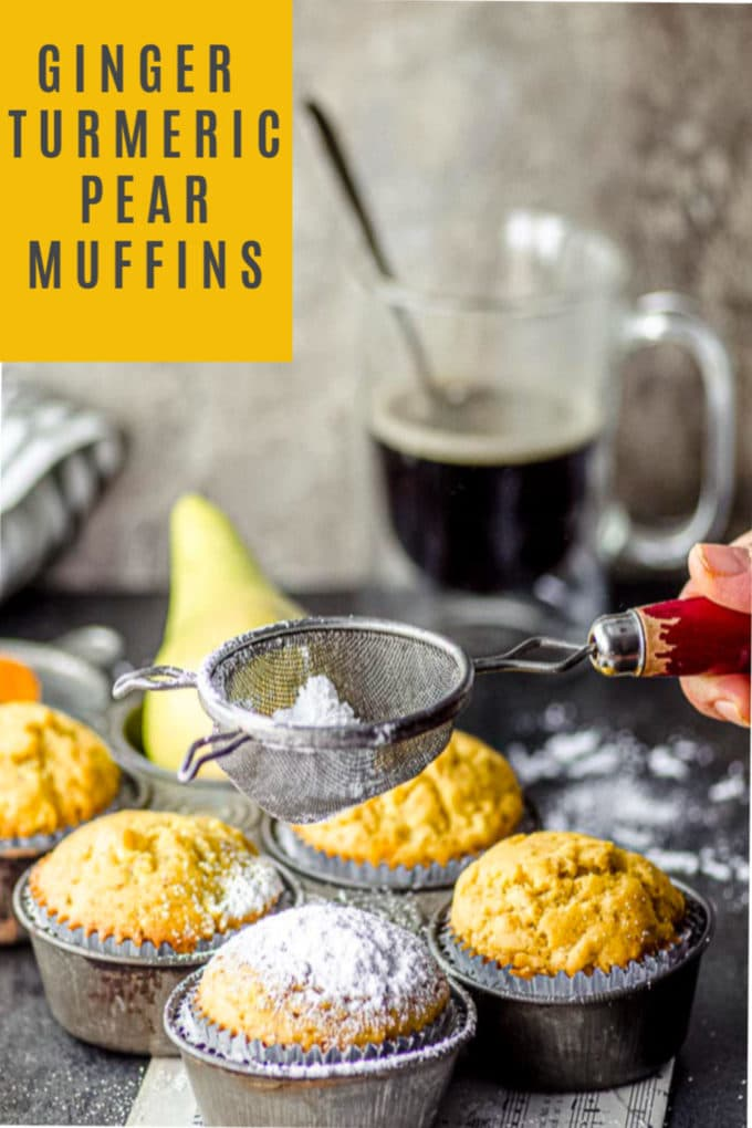 Sprinkling powdered sugar on ginger, turmeric and pear muffins