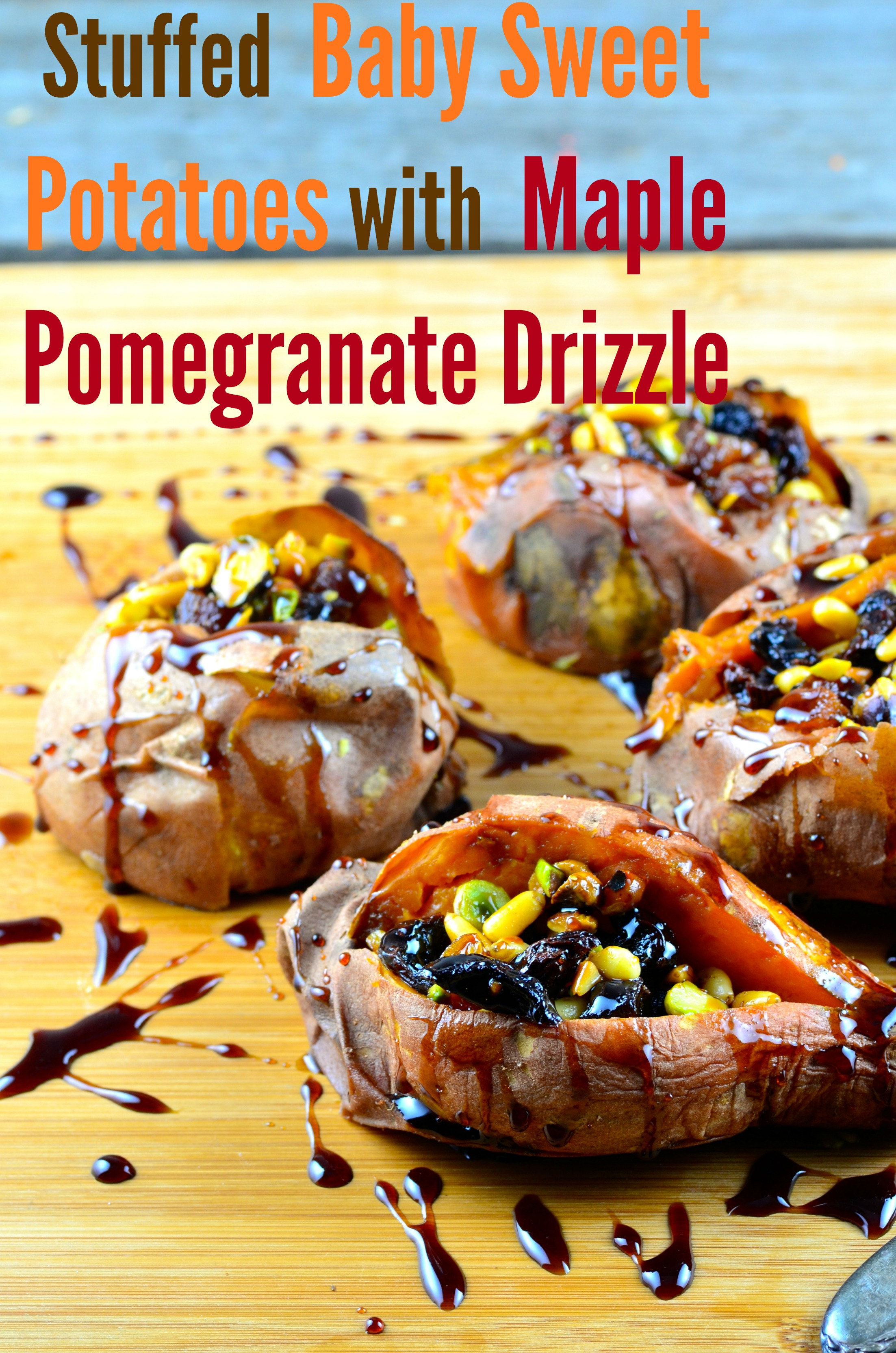 Roasted Sweet potatoes stuffed with dried fruit and drizzled with a maple pomegranate glaze on a wood board