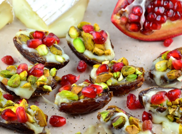 Dates Stuffed with Warm Brie Pistachios and Pomegranates - Do you want to surprise your guests on your next dinner party?  This Cheese stuffed date appetizer is  out of this world, warm, creamy, crunchy and tangy at the same time. Simply irresistible! #Rosh Hashanah #vegetarian #appetizer #Kosher #holiday #superBowl #Thanksgiving #holiday