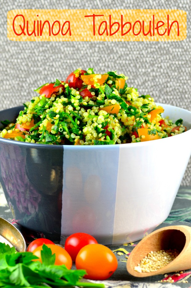 Close up view of a grey bowl filled with Passover Quinoa Tabbouleh