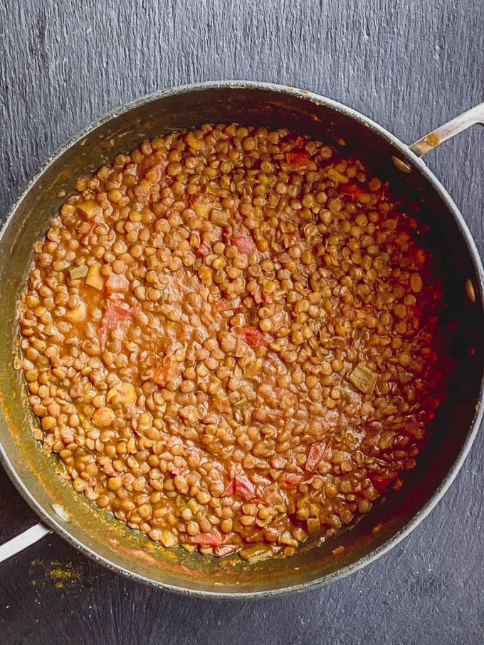 Cooked curry lentil dish in a pan
