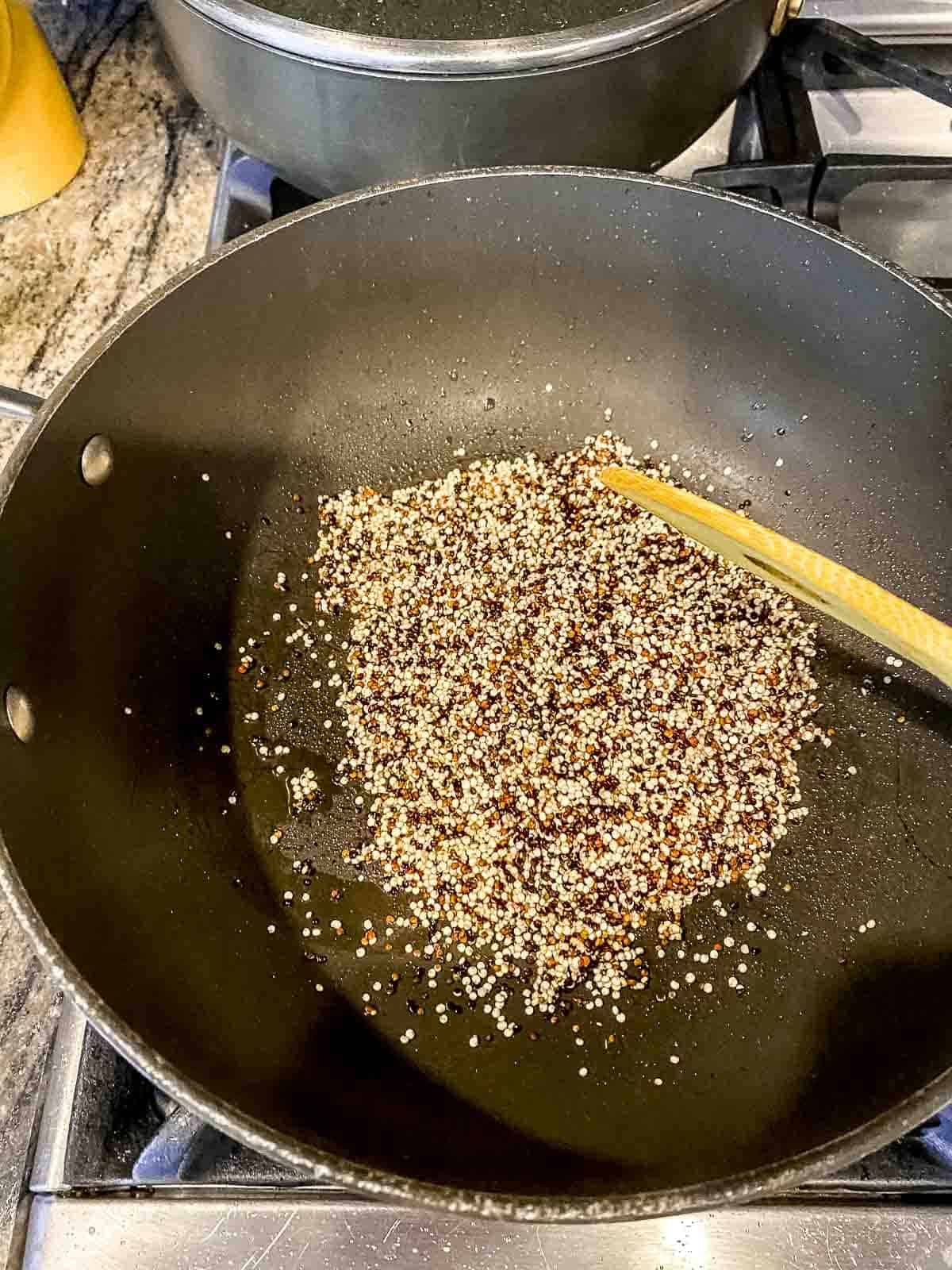 Sauteing quinoa and oil in a pot