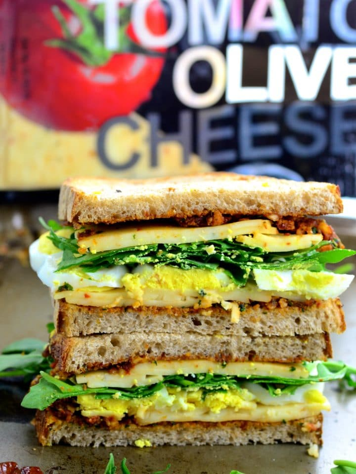 Crunchy Tomato Olive Cheese Vegetarian Picnic Sandwich - home made sundried tomato spread , crunchy multigrain sour dough bread, creamy cheese, fresh arugula and satisfying egg.
