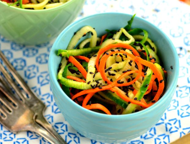 Spiralized Cucumber & Carrot Noodle Salad - it only takes 5 minutes to make this refreshing and healthy summer salad with tangy rice vinegar and nutty sesame seeds.