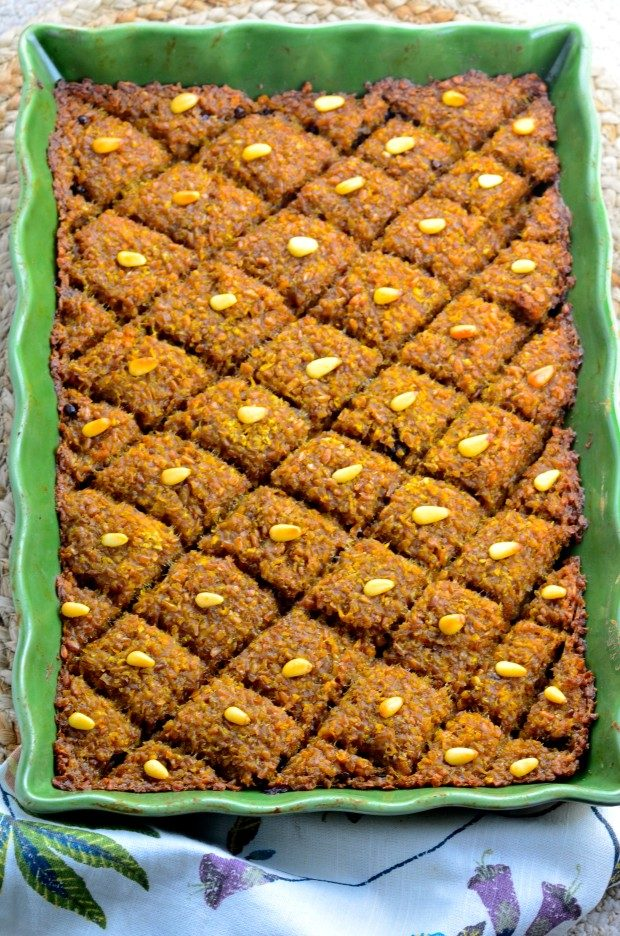 A meatless pumpkin kibbeh in a green rectangular baking dish