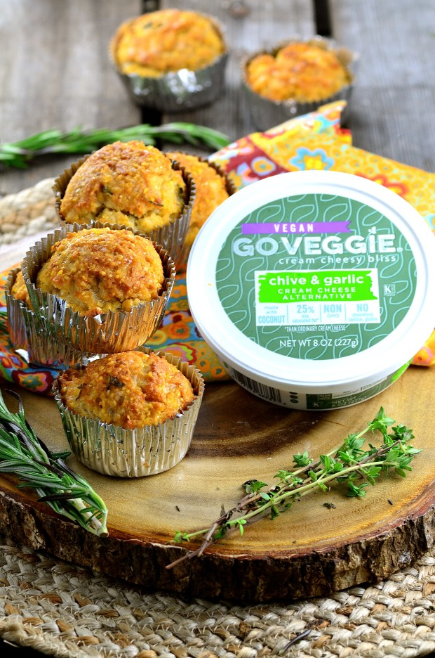 Vegan cheese corn muffins with a tub of vegan cream cheese