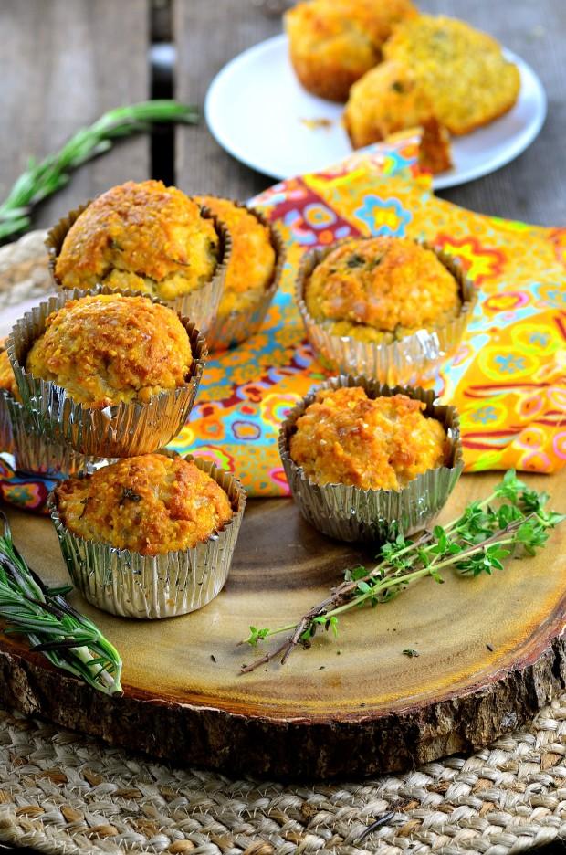 Six vegan cheese corn muffins on a wood board